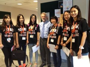 Dr. Jacque Carter, Doane College President, with 6 international students from China.